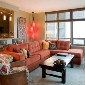 condo-living-room-design-with-decorative-corner-pendant-lights-and-wall-decor-and-coral-sectional-sofa-and-brown-side-chair-and-coffee-table-300x300.jpg